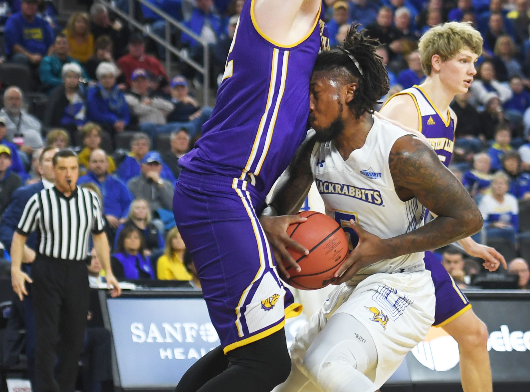 SDSU's David Jenkins goes against Western Illinois' Brandon Gilbeck during the game Saturday, March 9, in the Summit League tournament at the Denny Sanford Premier Center in Sioux Falls.