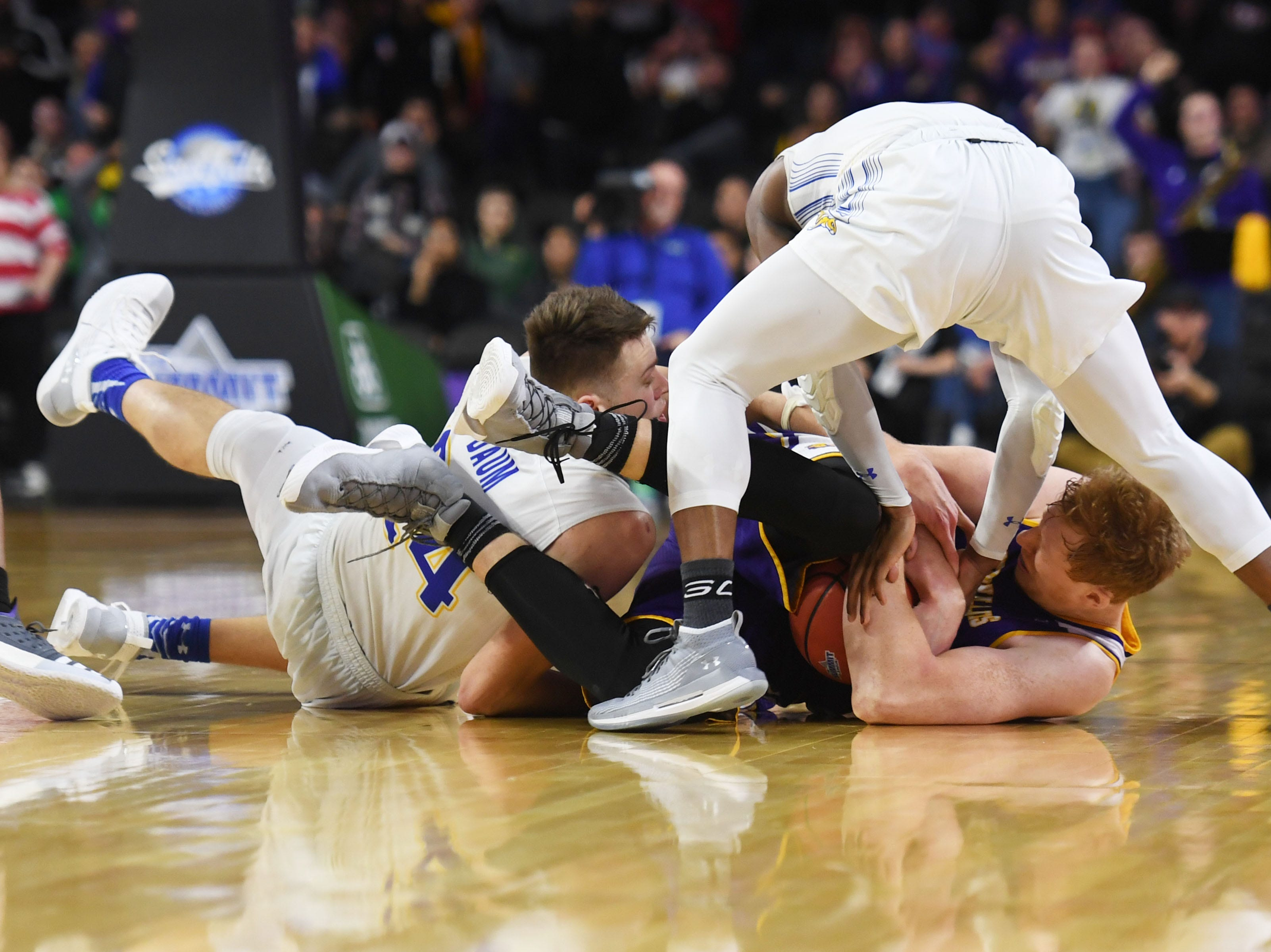 Western Illinois' Brandon Gilbeck hangs onto the ball against SDSU Saturday, March 9, in the Summit League tournament at the Denny Sanford Premier Center in Sioux Falls.