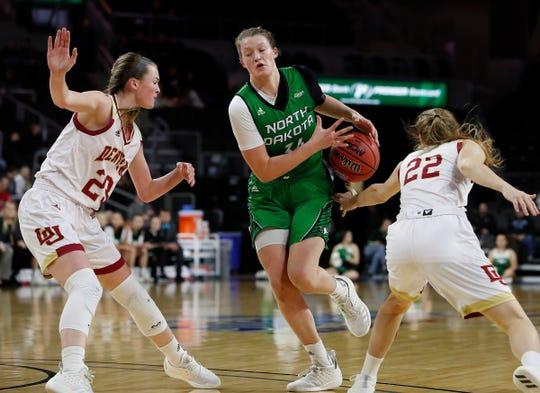 Lexi Klabo loses handle of the ball in between Denver's Madison Nelson (left) and Samantha Romanowski at the 2019 Summit League basketball tournament.
