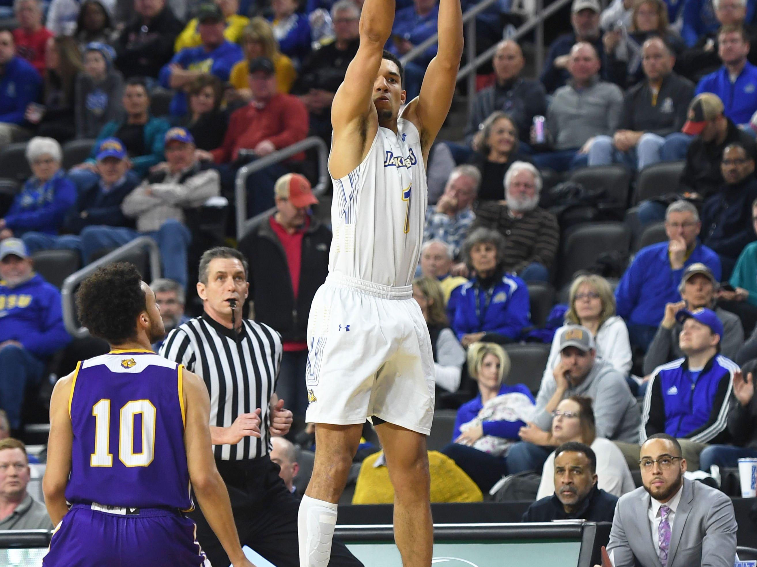 SDSU's Skyler Flatten attempts a three pointer during the game against Western Illinois Saturday, March 9, in the Summit League tournament at the Denny Sanford Premier Center in Sioux Falls.
