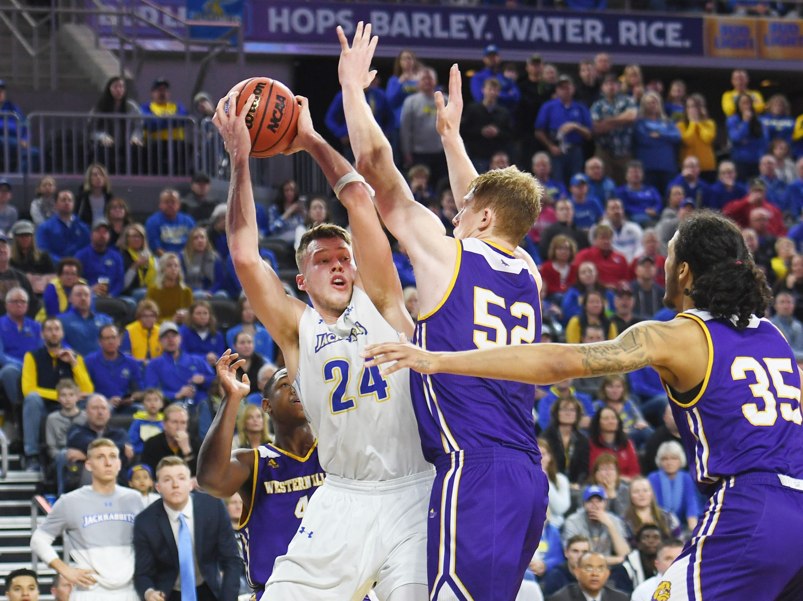 SDSU's Mike Daum goes against Western Illinois' Brandon Gilbeck during the game Saturday, March 9, in the Summit League tournament at the Denny Sanford Premier Center in Sioux Falls.