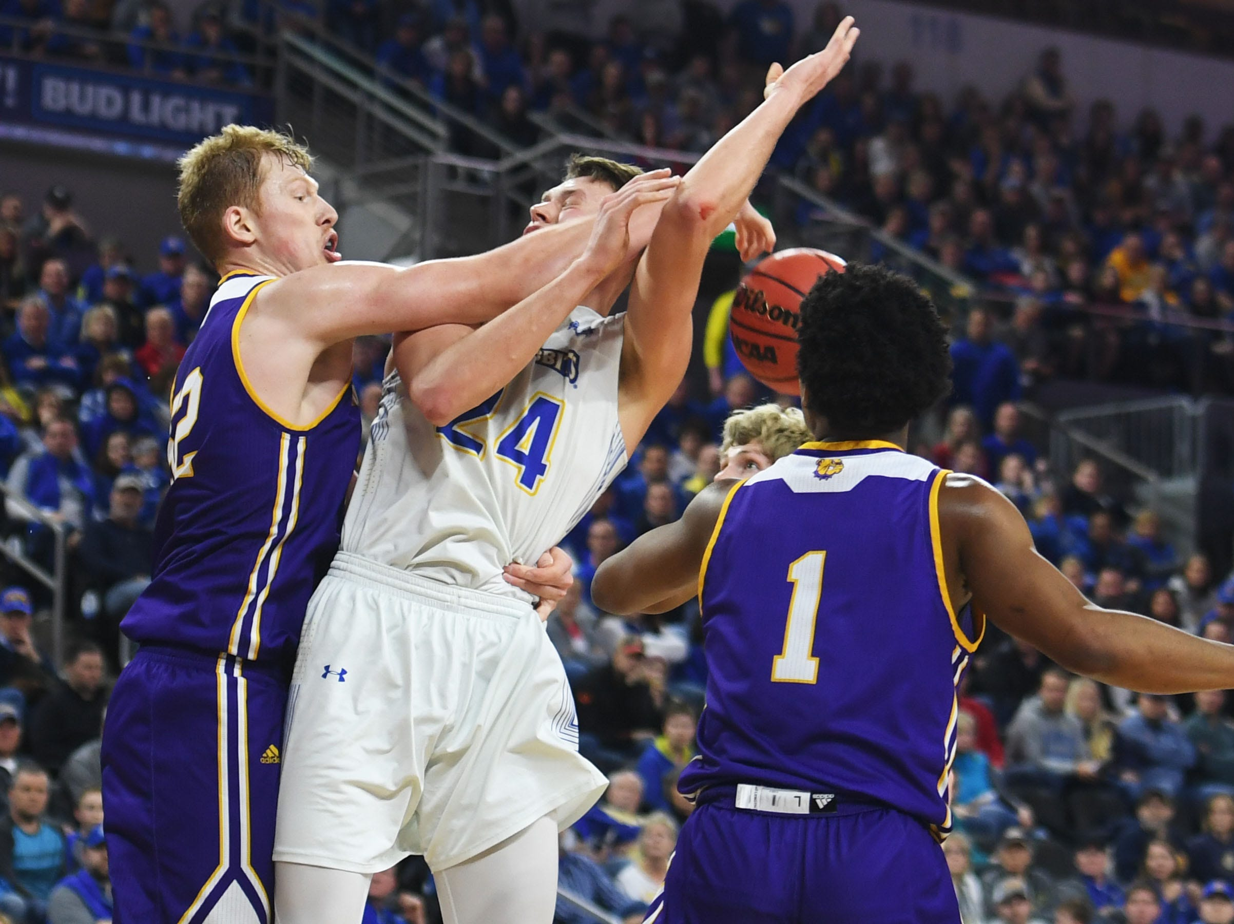 SDSU's Mike Daum attempts to score against Western Illinois' Brandon Gilbeck during the game Saturday, March 9, in the Summit League tournament at the Denny Sanford Premier Center in Sioux Falls.
