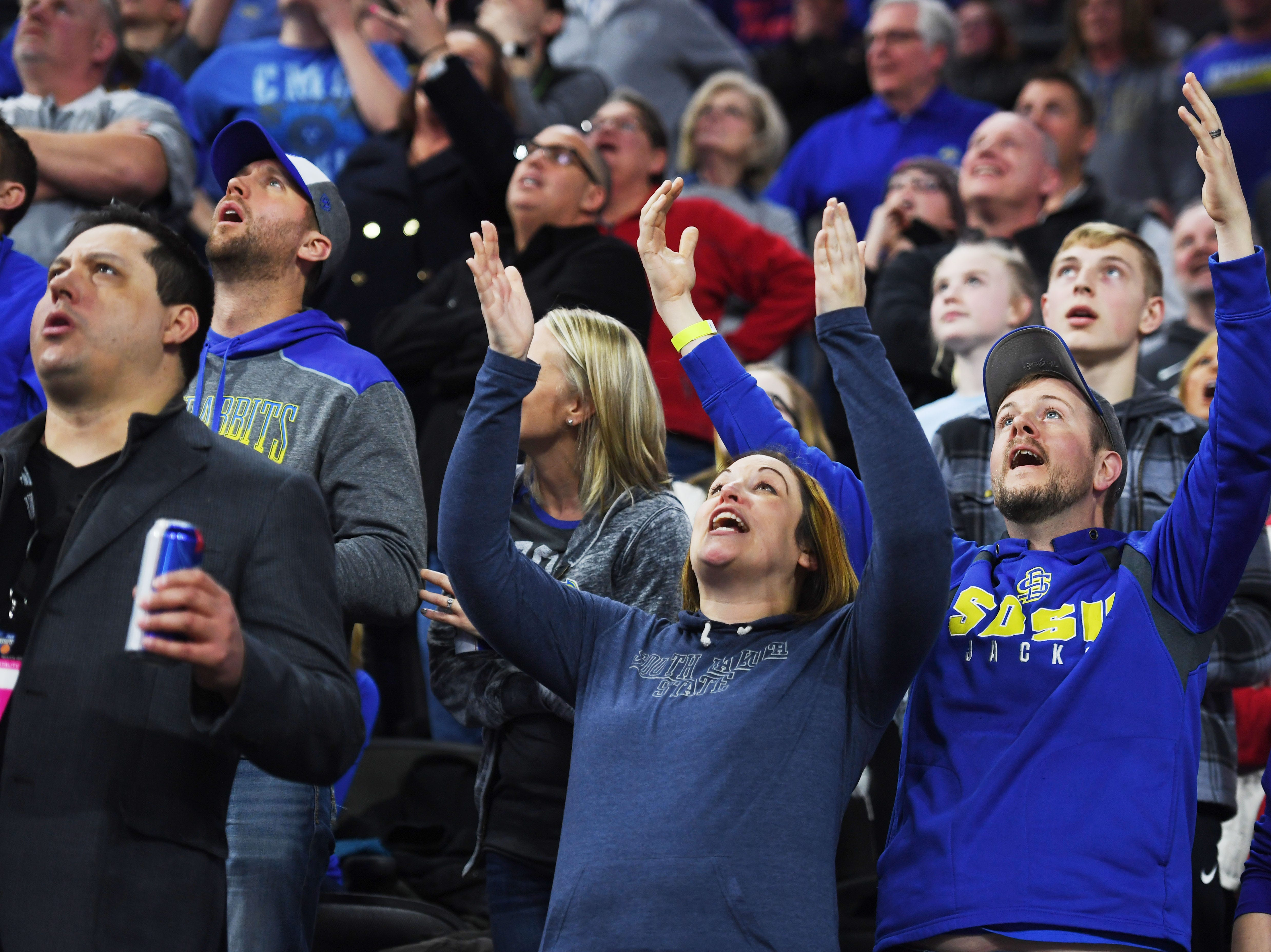 SDSU fans react to a call during the game against Western Illinois Saturday, March 9, in the Summit League tournament at the Denny Sanford Premier Center in Sioux Falls.