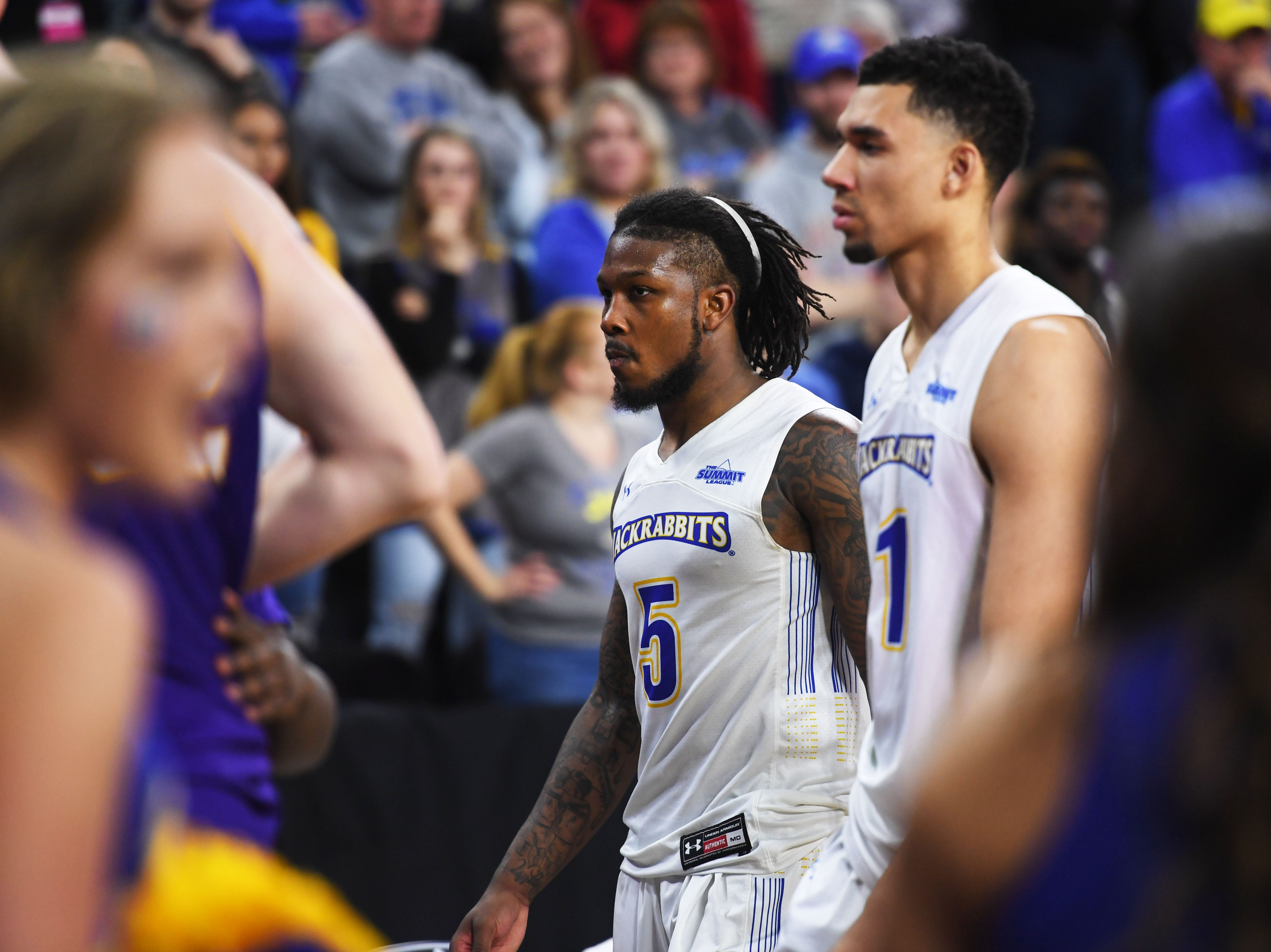 SDSU's David Jenkins (5) and Skyler Flatten (1) walk off the court after their lose against Western Illinois Saturday, March 9, in the Summit League tournament at the Denny Sanford Premier Center in Sioux Falls.