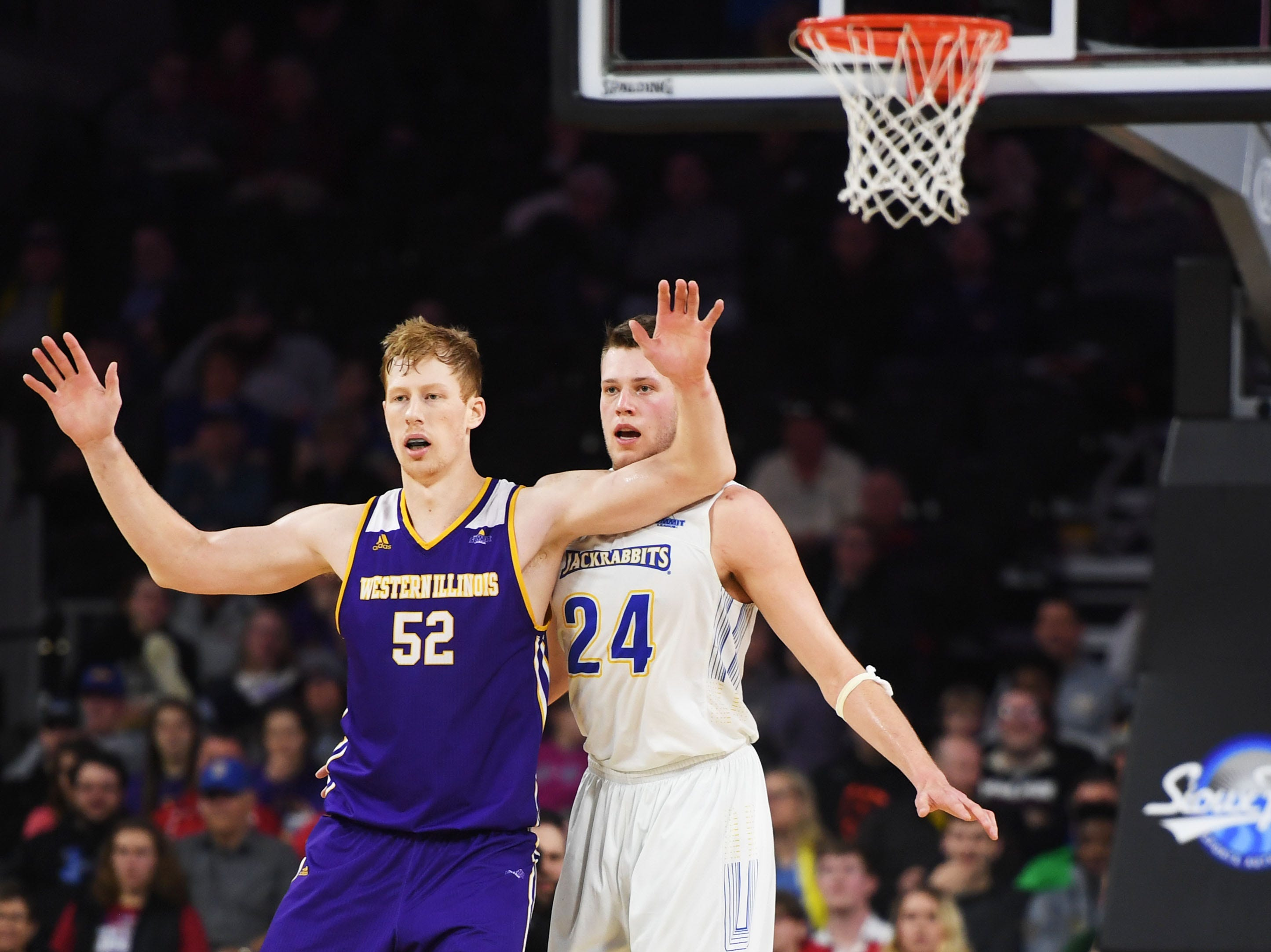 SDSU's Mike Daum and Western Illinois' Brandon Gilbeck during the game Saturday, March 9, in the Summit League tournament at the Denny Sanford Premier Center in Sioux Falls.