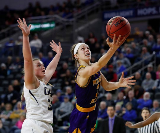SIOUX FALLS, SD - MARCH 10: Taylor Higginbotham #24 from Western Illinois attempts a layup in front of #33 from Oral Roberts at the 2019 Summit League Basketball Tournament at the Denny Sanford Premier Center in Sioux Falls. (Photo by Dick Carlson/Inertia)