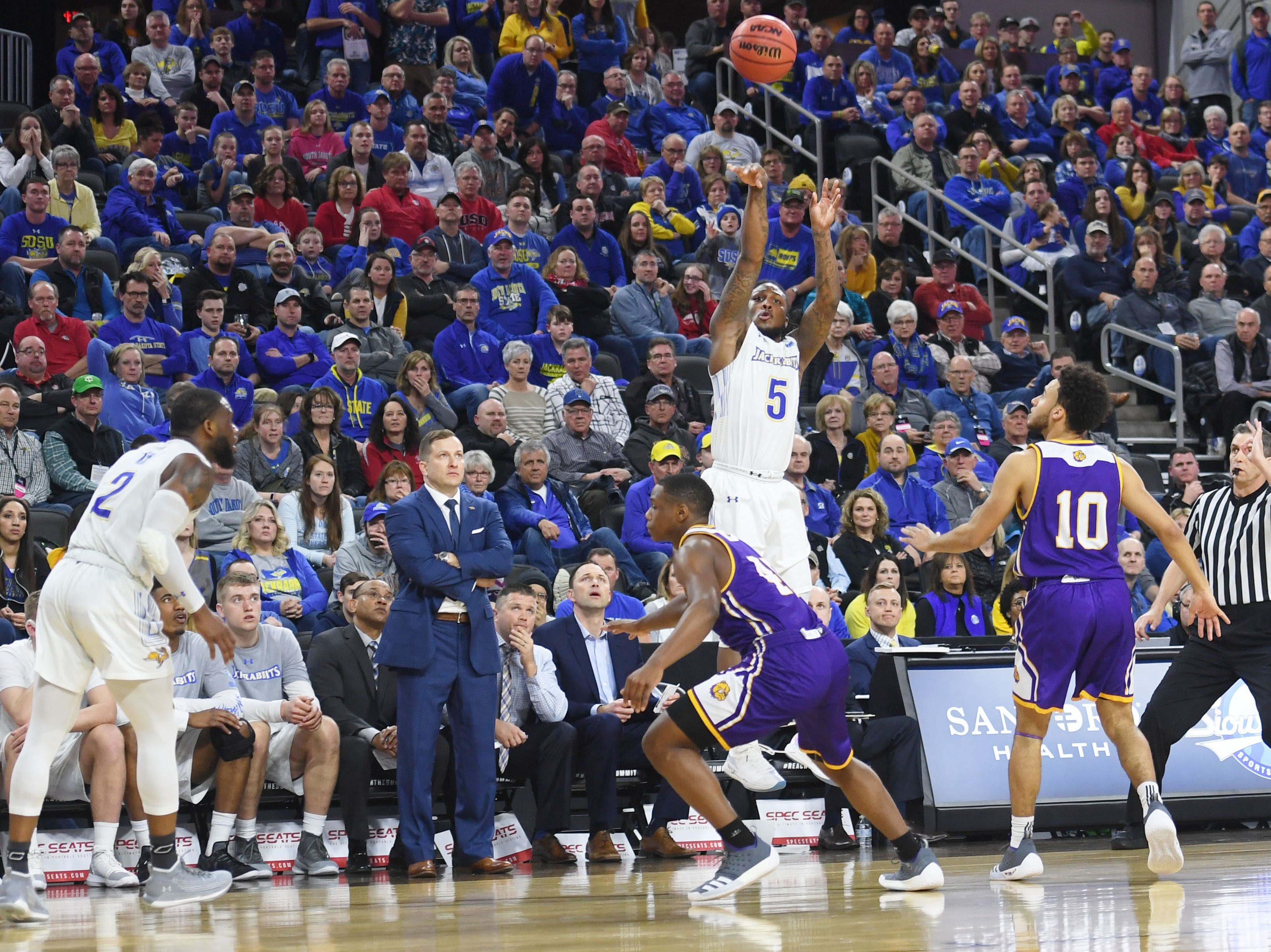 SDSU's David Jenkins goes against Western Illinois defense during the game Saturday, March 9, in the Summit League tournament at the Denny Sanford Premier Center in Sioux Falls.