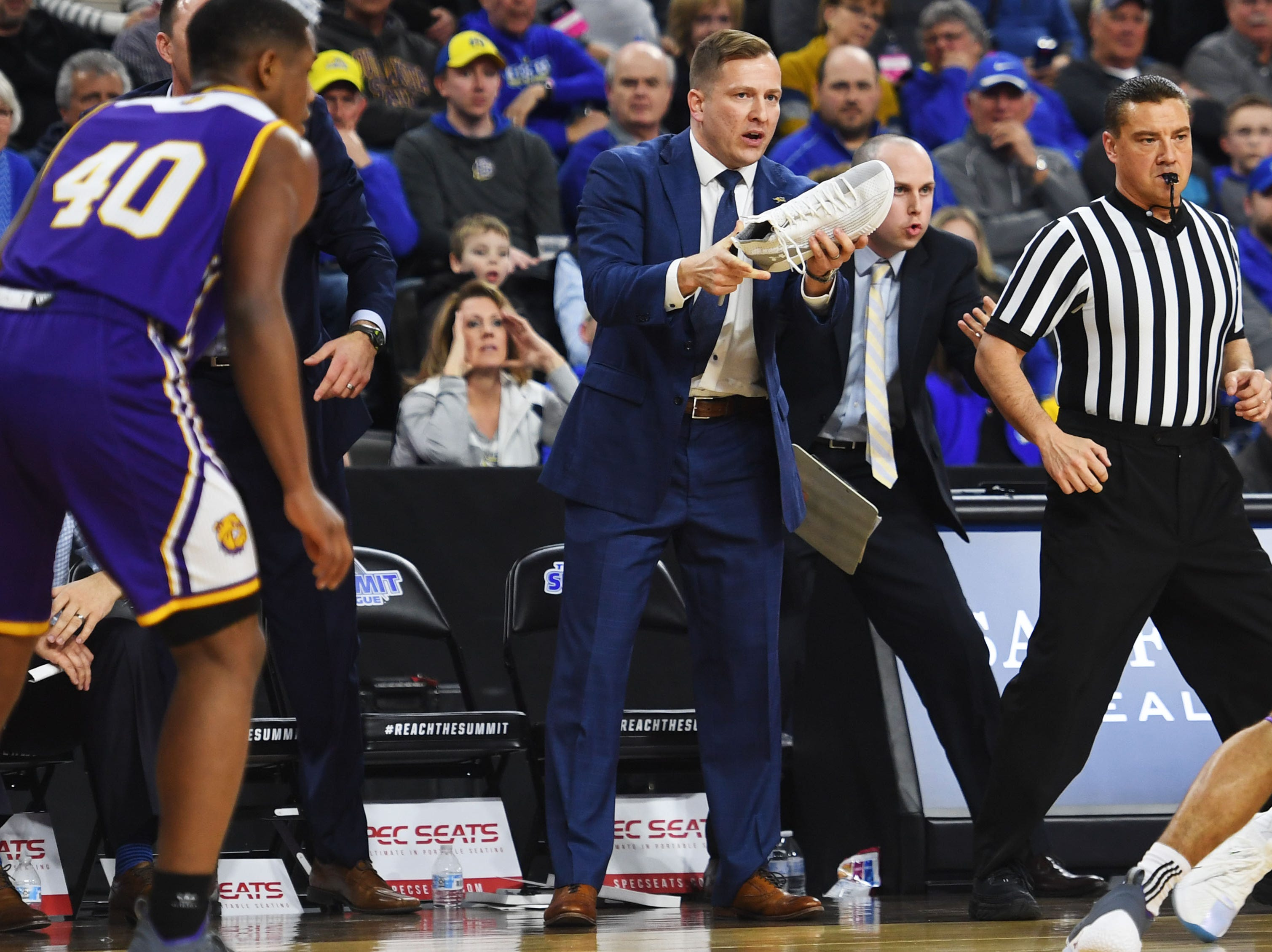 SDSU's head coach T.J. Otzelberger yells at Mike Daum in the game after he looses his shoe during the game against Western Illinois Saturday, March 9, in the Summit League tournament at the Denny Sanford Premier Center in Sioux Falls.