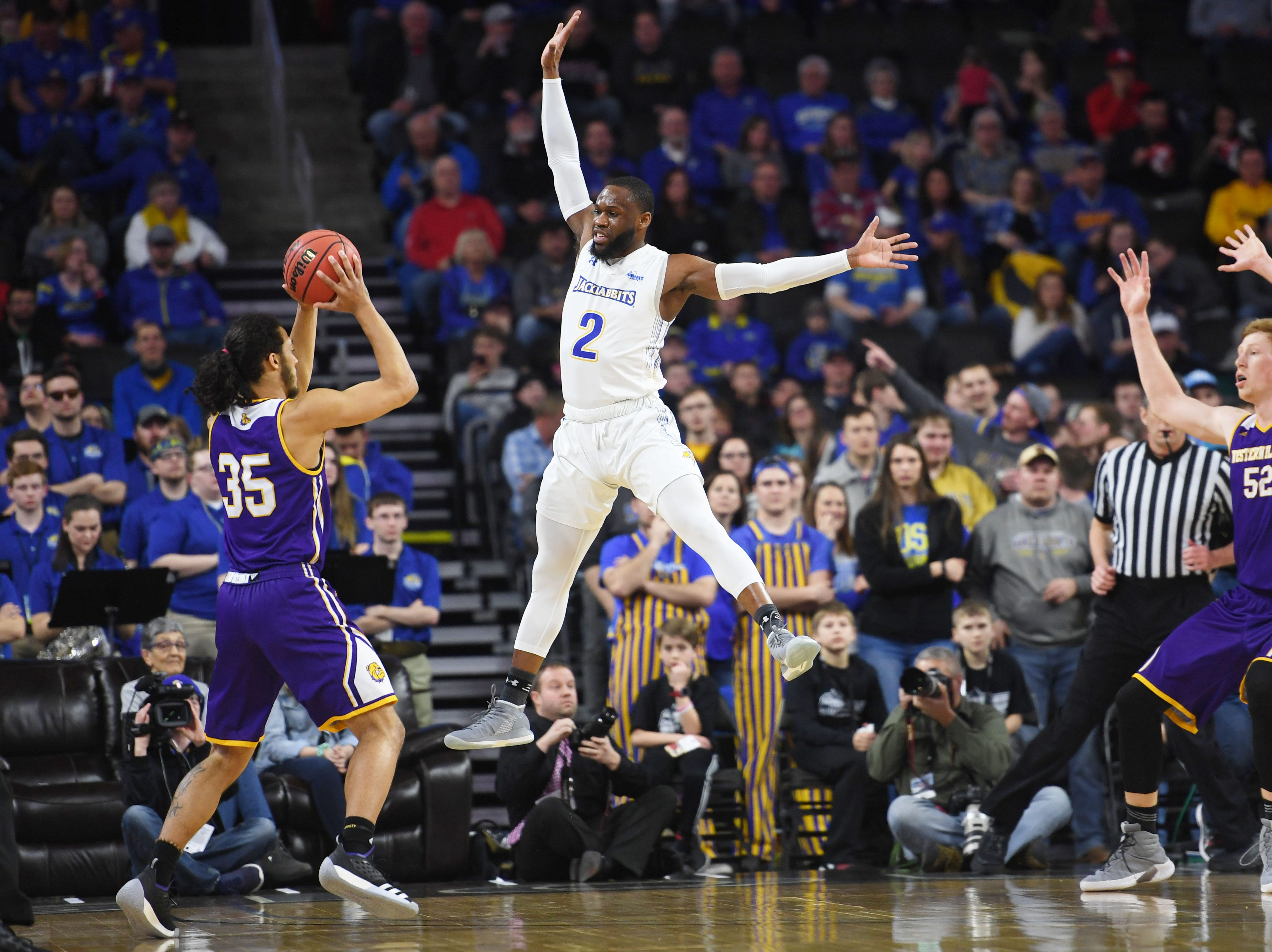 SDSU's Tevin King attempts to block Western Illinois' Isaac Johnson from taking a shot during the game Saturday, March 9, in the Summit League tournament at the Denny Sanford Premier Center in Sioux Falls.