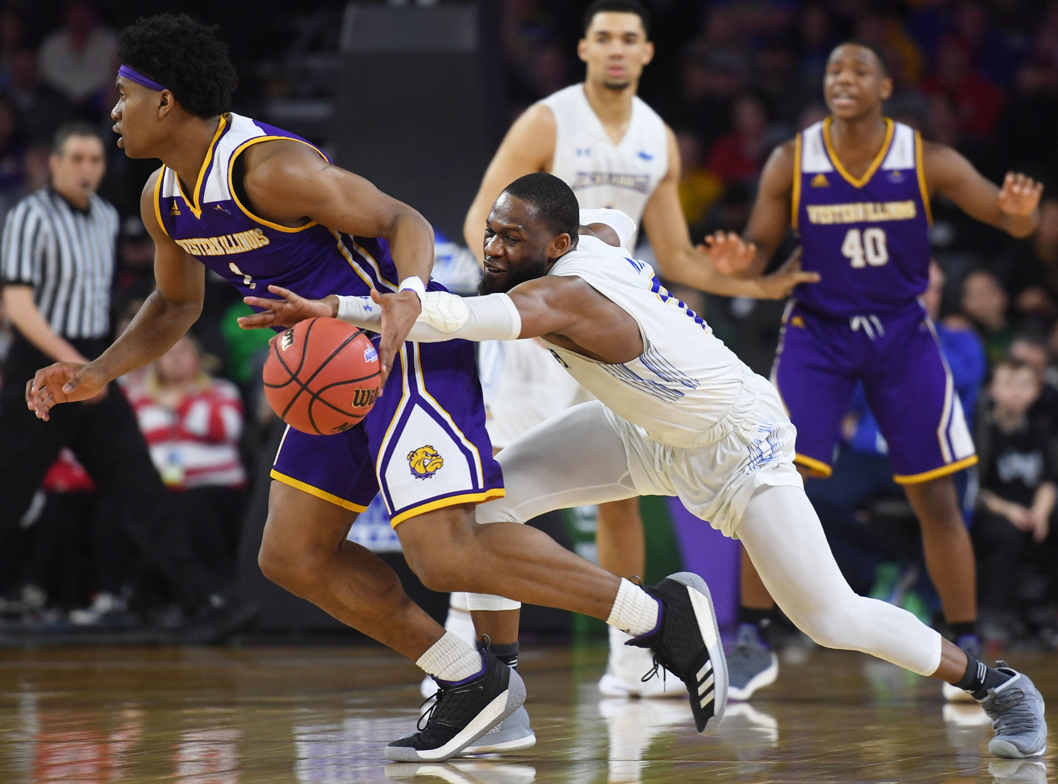 SDSU's Tevin King attempts to gain control of the ball during the game against Western Illinois Saturday, March 9, in the Summit League tournament at the Denny Sanford Premier Center in Sioux Falls.