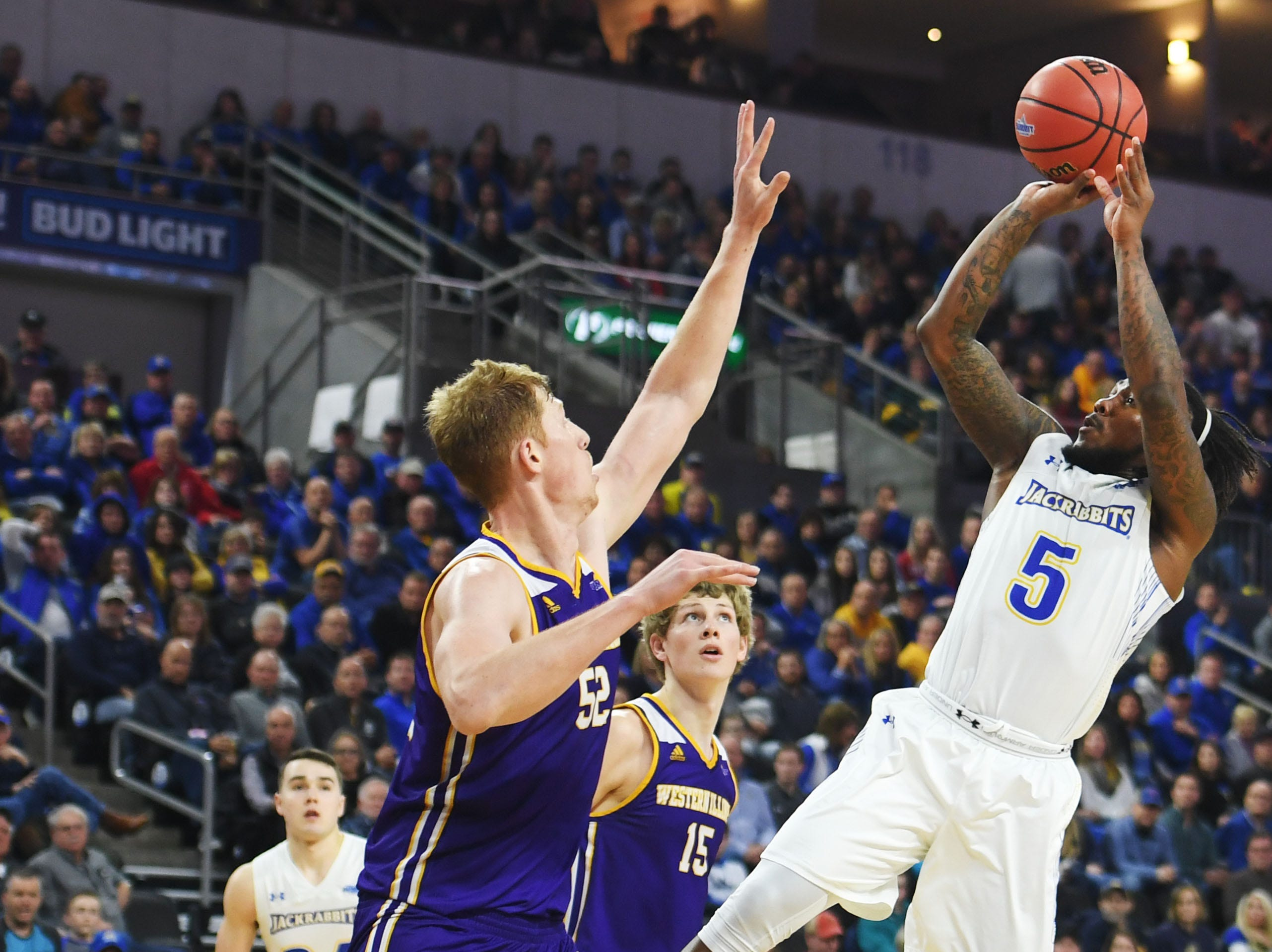 SDSU's David Jenkins attempts to score against Western Illinois' Brandon Gilbeck during the game Saturday, March 9, in the Summit League tournament at the Denny Sanford Premier Center in Sioux Falls.
