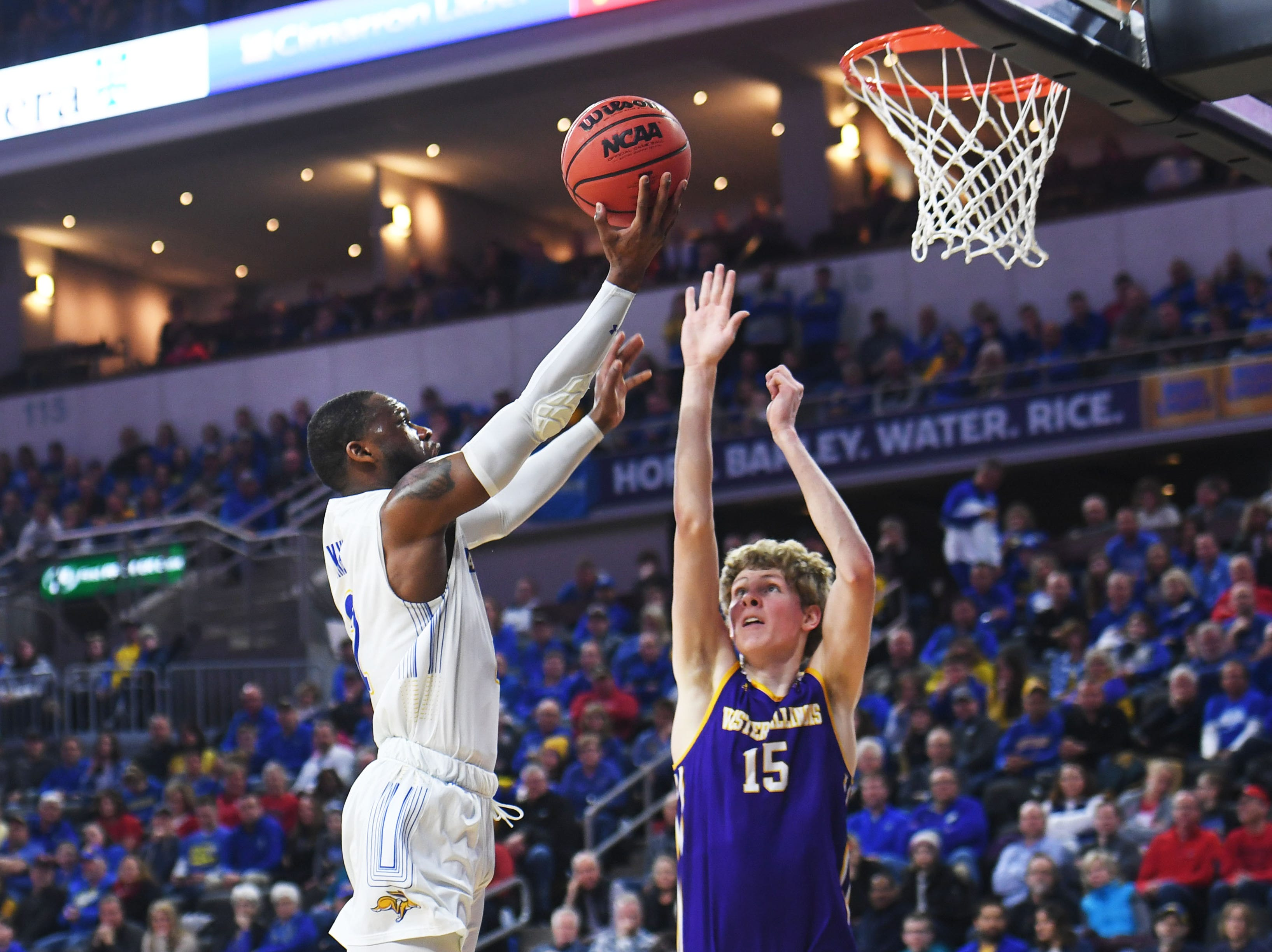 SDSU's Tevin King attempts to take a shot against Western Illinois' Ben Pyle during the game Saturday, March 9, in the Summit League tournament at the Denny Sanford Premier Center in Sioux Falls.