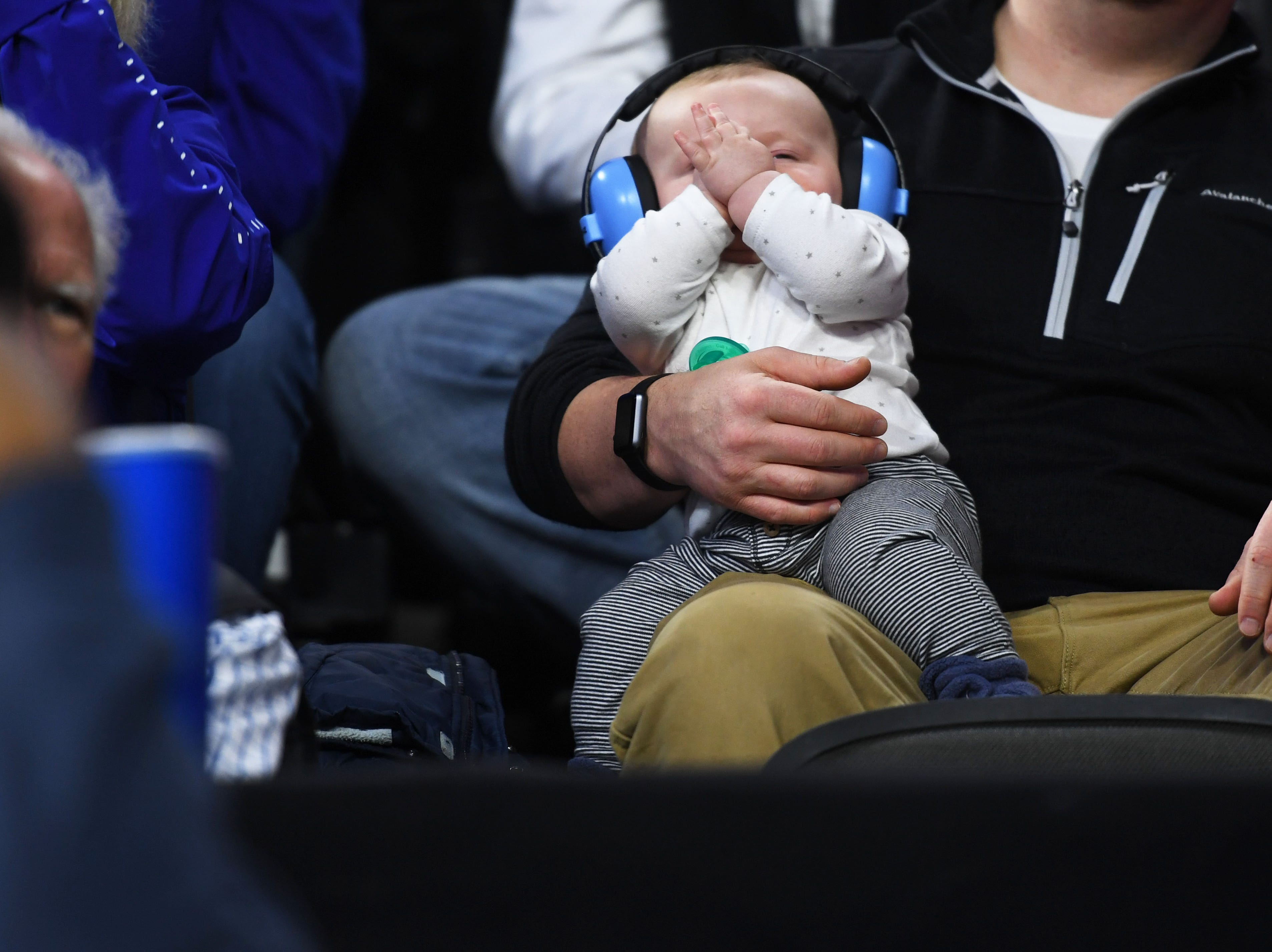 A baby closes it's eyes during the SDSU vs. Western Illinois game Saturday, March 9, in the Summit League tournament at the Denny Sanford Premier Center in Sioux Falls.