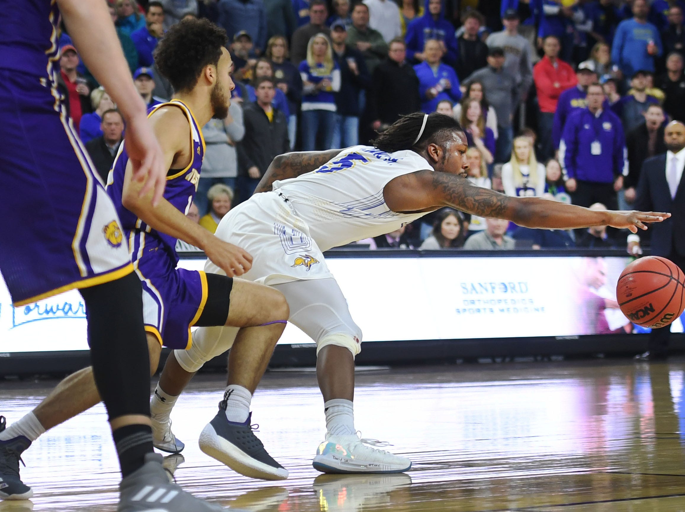 SDSU's David Jenkins attempts to gain control of the ball during the game against Western Illinois Saturday, March 9, in the Summit League tournament at the Denny Sanford Premier Center in Sioux Falls.