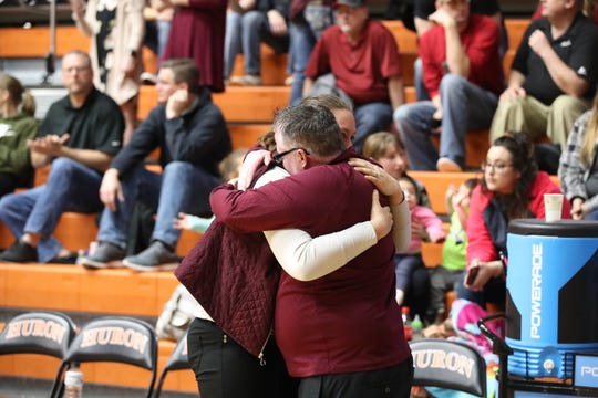 De Smet coach Doug Osthus embraces one of his assistant coaches following the No. 2 Bulldogs' win over No. 1 Ethan  in the Class B state championship game.