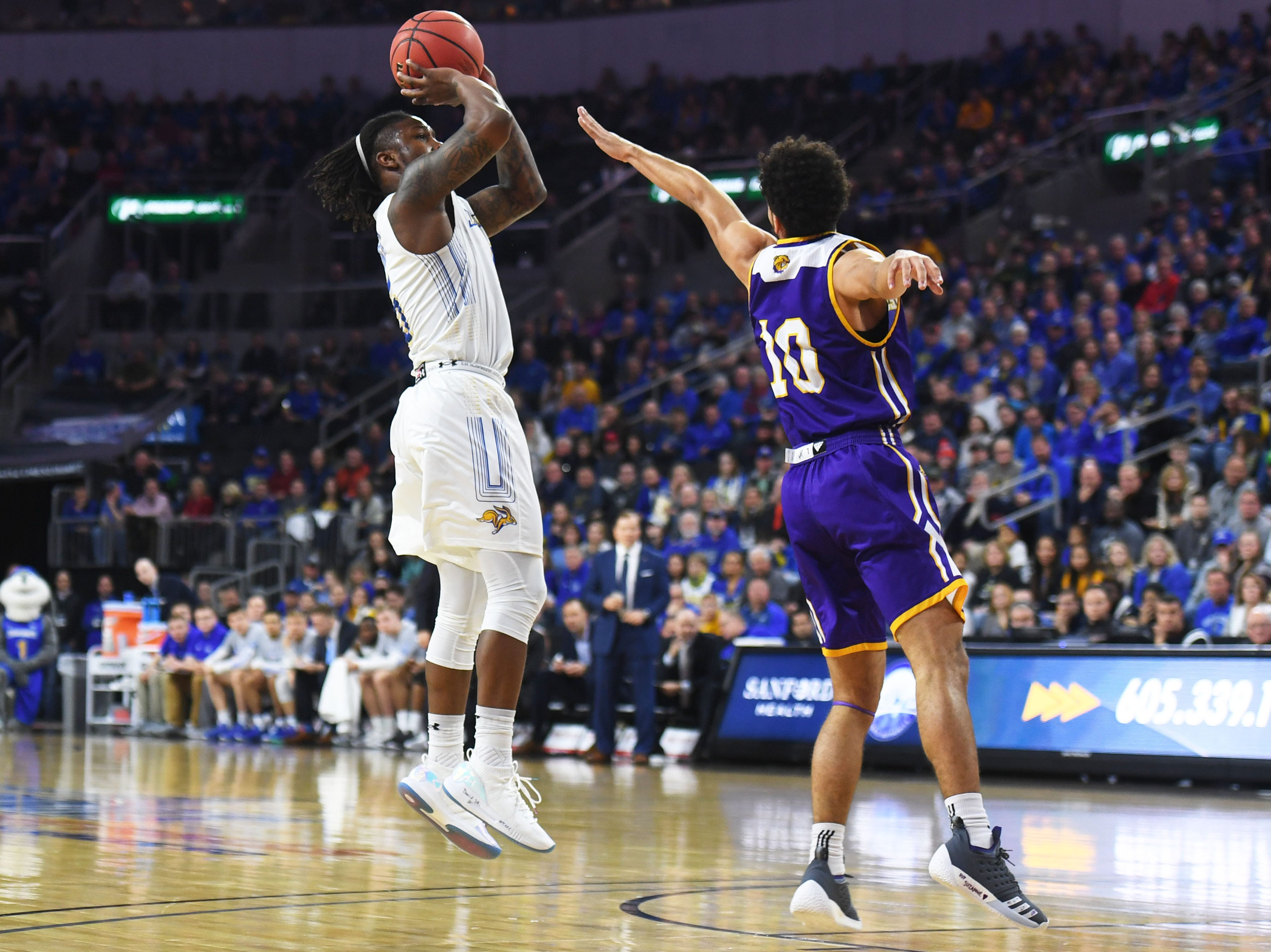 SDSU's David Jenkins takes a shot against Western Illinois Saturday, March 9, in the Summit League tournament at the Denny Sanford Premier Center in Sioux Falls.