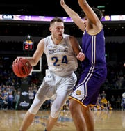 SIOUX FALLS, SD - MARCH 9: Mike Daum #24 from South Dakota State posts up against Jordan Hughes #44 of Western Illinois at the 2019 Summit League Basketball Tournament at the Denny Sanford Premier Center in Sioux Falls. (Photo by Dick Carlson/Inertia)