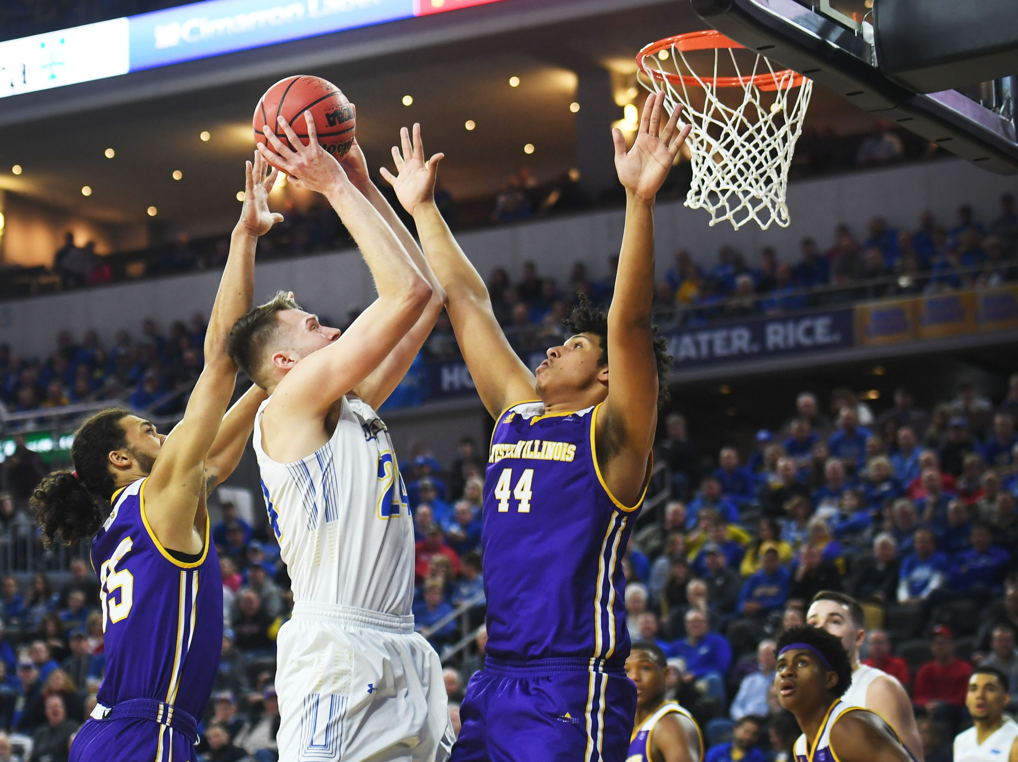 SDSU's Mike Daum goes against Western Illinois defense during the game Saturday, March 9, in the Summit League tournament at the Denny Sanford Premier Center in Sioux Falls.