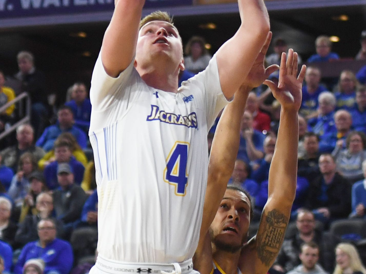 SDSU's Ryan Krueger attempts to score against Western Illinois during the game Saturday, March 9, in the Summit League tournament at the Denny Sanford Premier Center in Sioux Falls.
