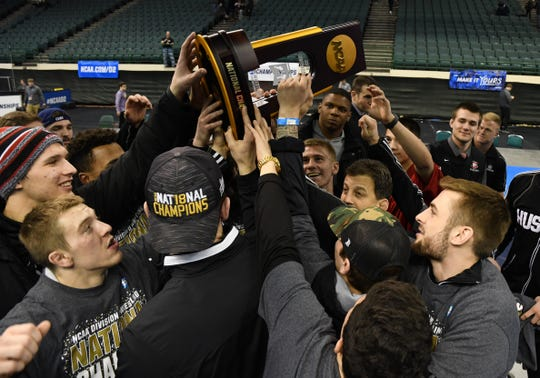 St. Cloud State wrestlers celebrate with the championship trophy at the 2019 NCAA Division II championships Saturday in Cleveland, Ohio.