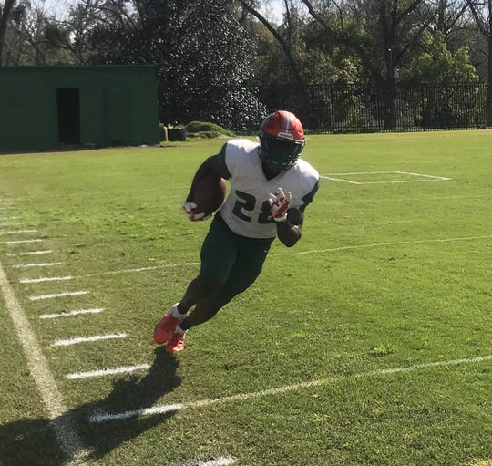 FAMU running back Ricky Henrilus races down the sideline after making a catch in practice on Saturday, March 9, 2019.