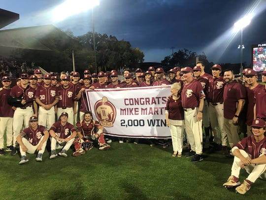 Mike and Carol Martin and the FSU baseball team following Saturday's 5-2 win over Virginia Tech at Howser Stadium.