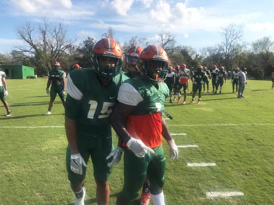 FAMU linebacker Elijah Richardson (15), cornerback Herman Jackson and nickleback Terry Jefferson huddle up during spring practice on Saturday, March 9, 2019.