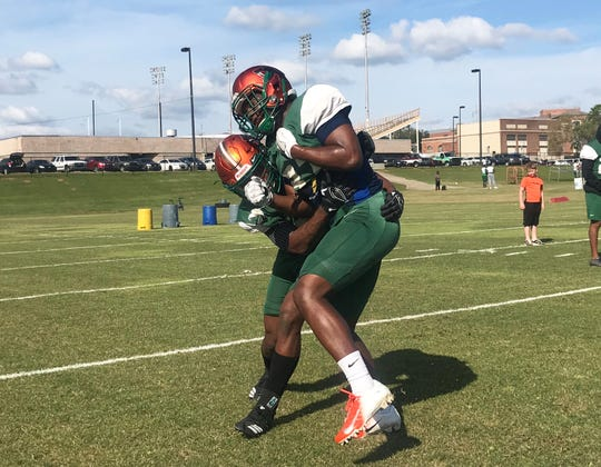 FAMU defensive backs go through tackling drills. Eric Smith (left) makes a hit on Traquan Butler on Saturday, March 9, 2019.