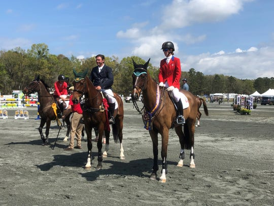 From left, Australian rider Clayton Fredericks on FE Ophelia stands next to Canadian Selena O'Hanlon on Foxwood High as the top two competitors overall Sunday at the Red Hills Horse Trials 2019. O'Hanlon won first place in the highest division at this year's trials.