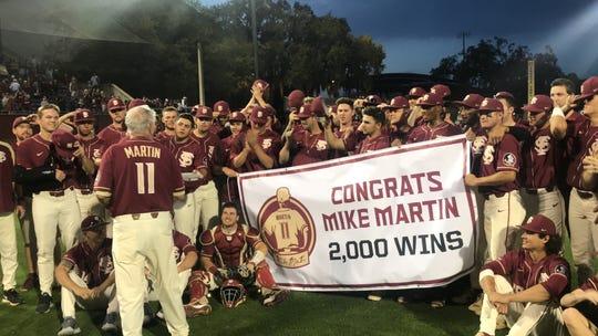 FSU celebrates coach Mike Martin's 2,000th win.