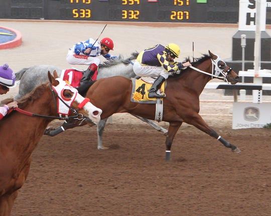 Jacky Martin 21 won the 400-yard, Grade III West Texas Quarter Horse Maturity on Saturday at Sunland Park Racetrack & Casino.