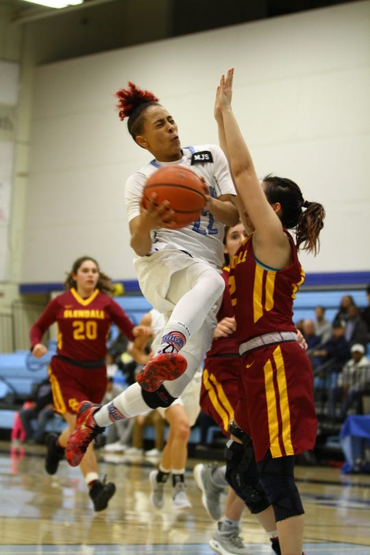 Moorpark College guard Breanna Calhoun drives to the basket during the CCCAA Southern California regional final against Glendale on Saturday night at Raider Pavilion. Moorpark won, 79-66.