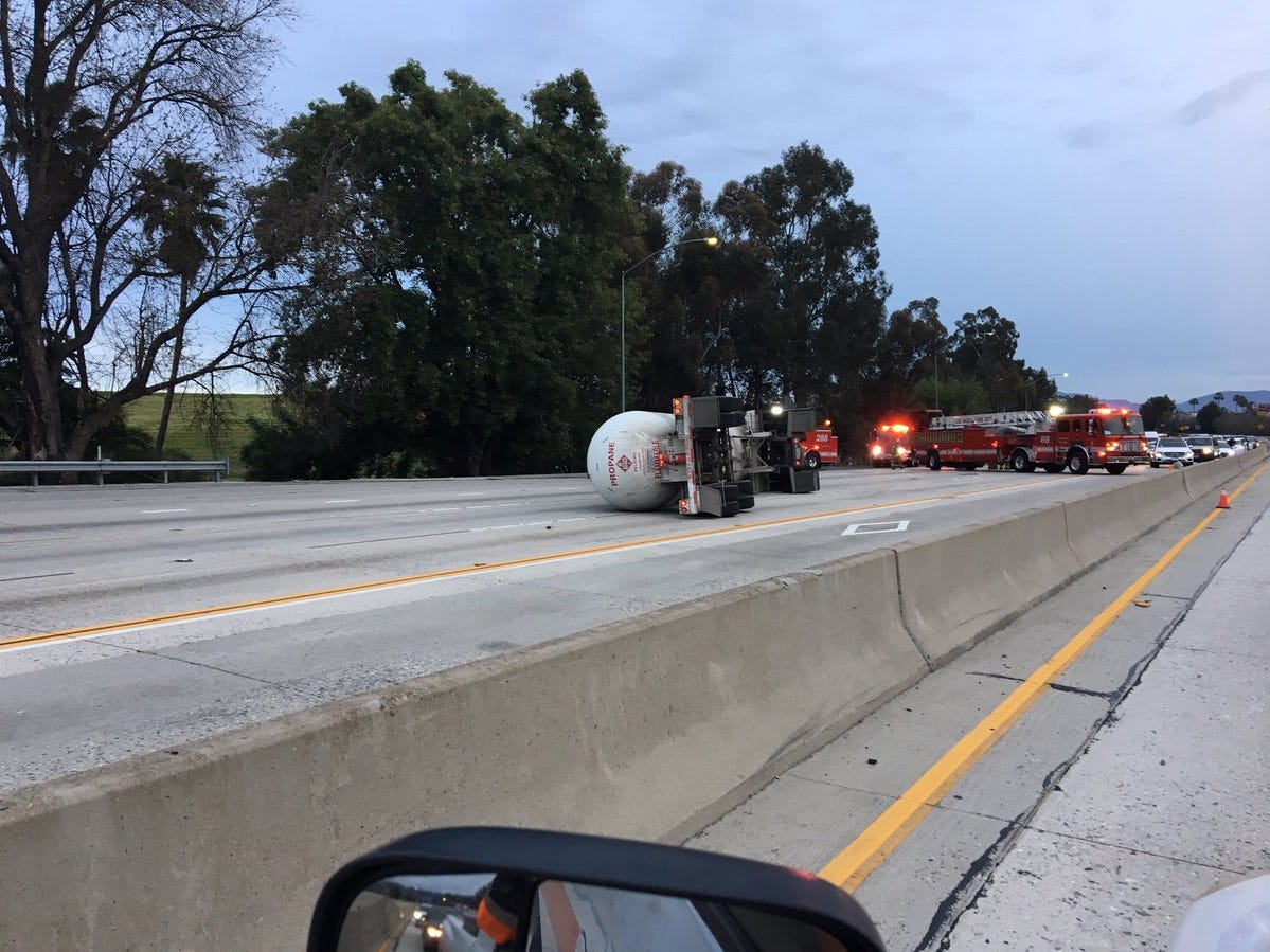 Traffic on southbound Interstate 405 backed up at the scene of an overturned tanker truck Sunday.