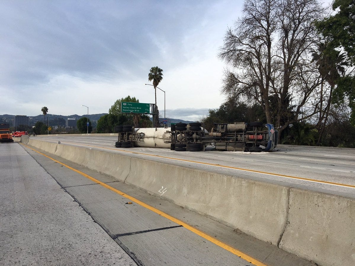 An overturned tanker truck closed Interstate 405 at Highway 101 Sunday along with some 101 connectors.