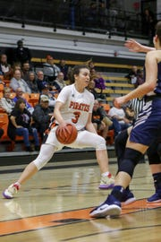 Ventura College freshman Cece Quintino dribbles past a defender during the CCCAA Southern California regional final against Irvine Valley on Saturday night in Ventura. Ventura won, 73-53.