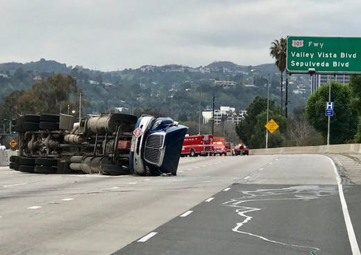 Overturned big rig blocks access from Highway 101 to I-405 and