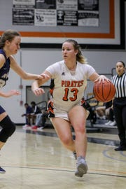 Ventura College freshman Emma Larson protects the ball during the CCCAA Southern California regional final against Irvine Valley on Saturday night in Ventura. Ventura won, 73-53.