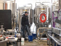 Roy Johnson, past president of the Master Brewers Association and South Jersey native, speaks about the historic rise in the beer brewing community at the Glasstown Brewing Company in Millville.