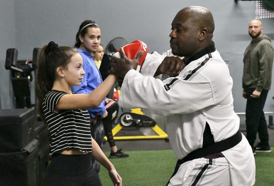 Michaela Franco learns a self defense technique from Sean Knox at Train Like  A Girl Studio's Dads and Daughters Self-defense course on Friday, March 8, 2019.