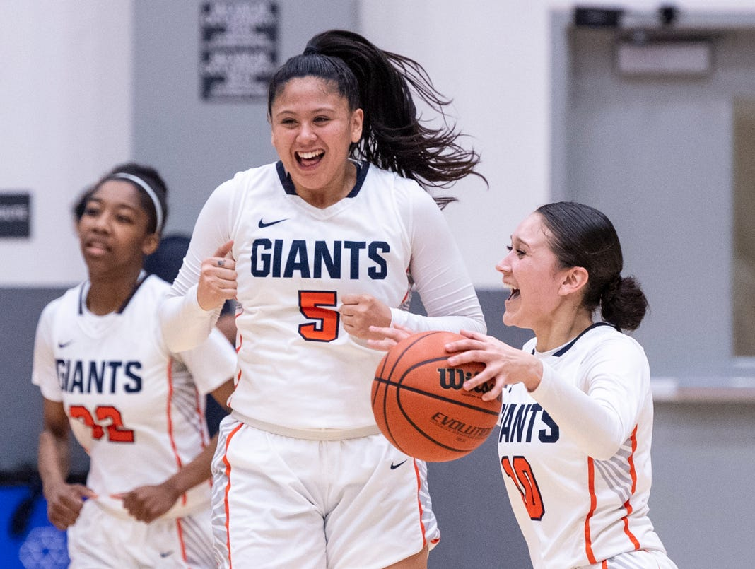 COS' Julianna Gutierrez, right, and Janelle Sumilong celebrate their win over San Francisco City College in a NorCal quarterfinal junior college basketball state playoff game on Saturday, March 9, 2019.
