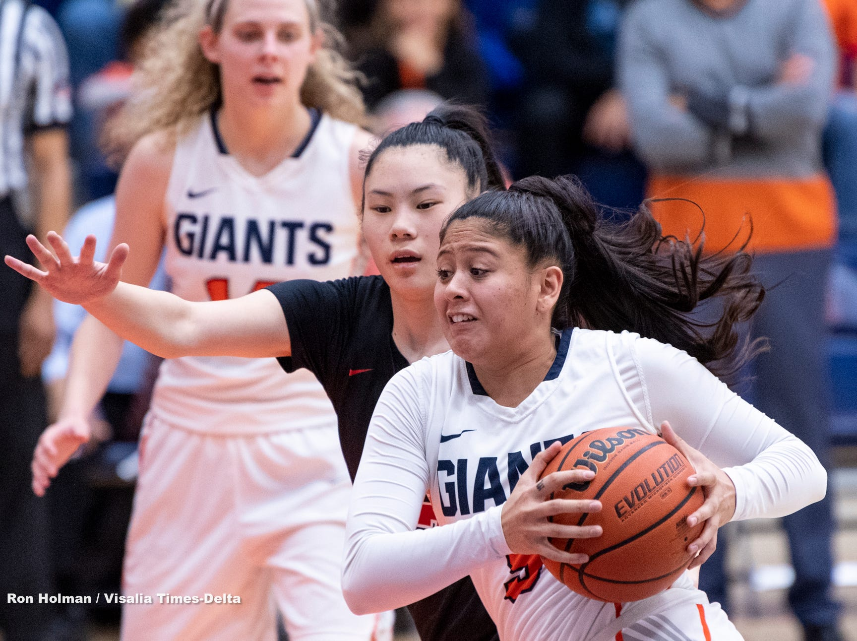 COS' Janelle Sumilong drives against San Francisco City College's Rika Baba in a NorCal quarterfinal junior college basketball state playoff game on Saturday, March 9, 2019.