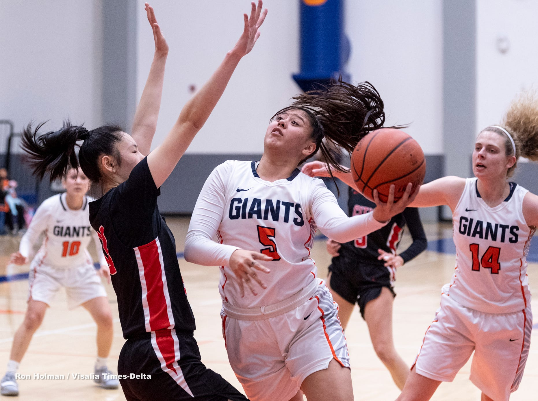 COS' Janelle Sumilong goes for two against San Francisco City College's Rika Baba in a NorCal quarterfinal junior college basketball state playoff game on Saturday, March 9, 2019.