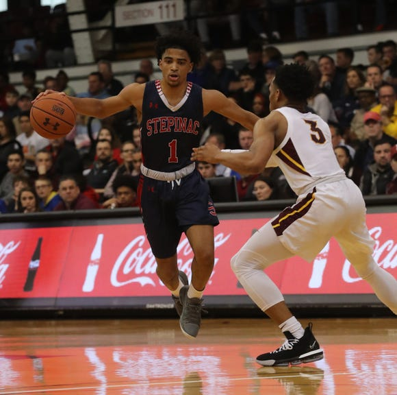 Stepinac's R.J. Davis drives to the basket during his team's 61-56 loss to Christ the King in the CHSAA championship game at Fordham University on March 10, 2019. Davis was picked first-team all-state.