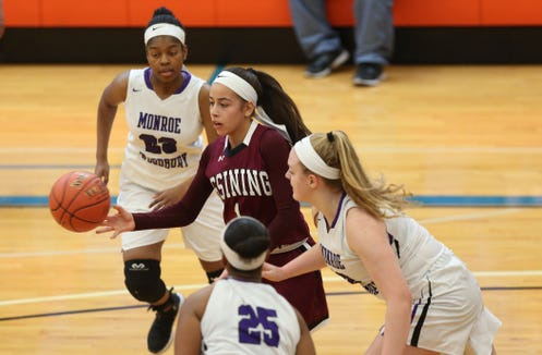 Ossining's Jaida Strippoli (1) looks for an open teammate against Monroe-Woodbury during the girls regional final at SUNY New Paltz Match 9, 2019. Ossining won the game 67-34.