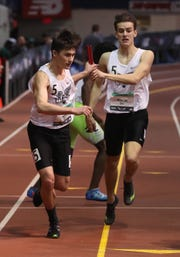 Eric Jacobson of Scarsdale hands off to DJ Matusz during the boys 4 x 400 relay during the New Balance Indoor Track & Field Nationals at The New Balance Armory in Manhattan March 10, 2019.