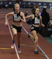 Betsy Marshall of Bronxville hands off to Caroline Brushear during the girls 4 x 400 relay during the New Balance Indoor Track & Field Nationals at The Balance Armory in Manhattan March 10, 2019.