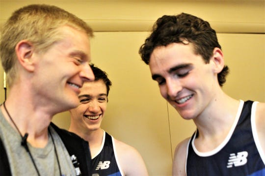 Bronxville coach Ian Clark and Tommy O'Connell share laugh with Matt Rizzo after Nationals gold-medal win.JPG