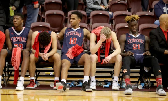 Stepinac players sit on the bench after the CHSAA basketball championship game at Fordham University March 10, 2019. Christ the King overcame a 14 point deficit to defeat Stepinac 61-56.