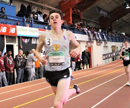Rye's Cian Galligan competes at 2019 New Balance Indoor Nationals wearing his grandfather's running singlet .
