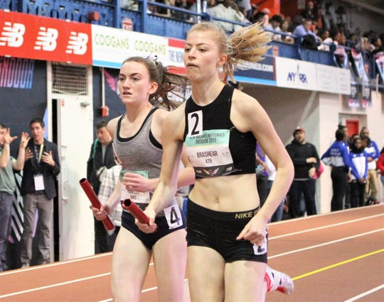 Suffern's Mary Hennelly (l) runs on the outside of Bronxville's Caroline Brashear during the 2019 New Balance Indoor Nationals girls  1,600 sprint medley relay.